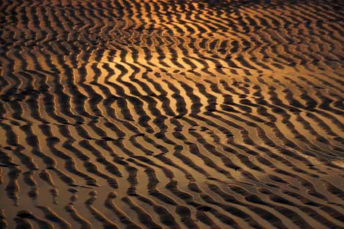 golfribbels zand Texel oranje